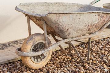 A muddy construction site wheelbarrow
