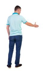 Back side view of man  in shirt handshake.