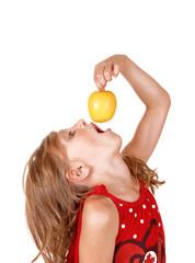 Girl eating an apple.