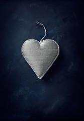 Vintage handmade christmas heart on black background