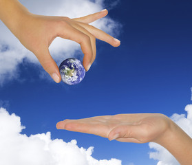female hand holding earth.