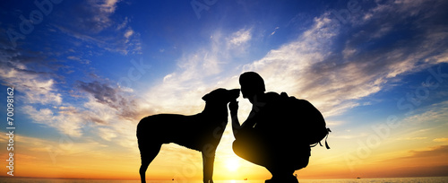 canvas print picture The boy with a dog