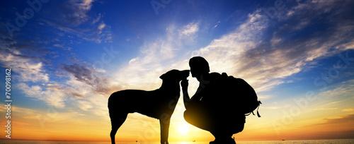Leinwanddruck Bild The boy with a dog