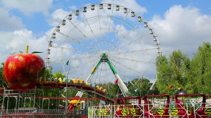 Ferris wheel and rides in the amusement park
