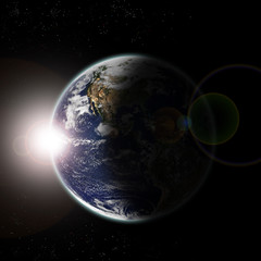 Earth seen from space at sun dawn and stars