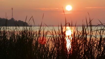 colorful sunrise at the lake bank