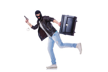 Robber with stolen suitcase and gun