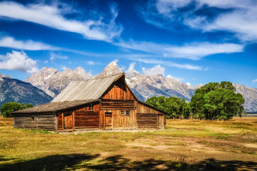 Grand Teton scenic view with abandoned barn on Mormon Row