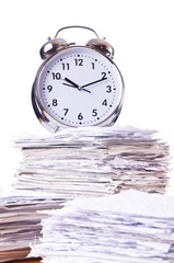 Stack of papers and clock isolated on white