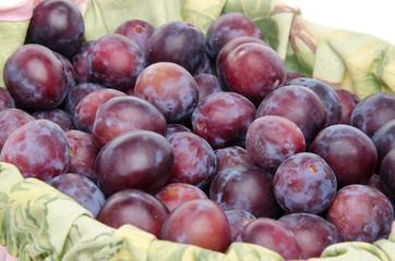 Fresh ripe blue plums in a basket