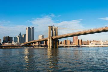 Brooklyn bridge in New York on bright summer day