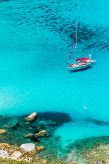 Sailboat anchored in Porto Giunco bay. Sardinia Island. Italy.