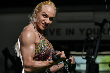 Woman Bodybuilder Doing Exercise For Biceps
