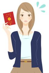 パスポートを持った焦る表情の女性