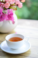 flower in fresh morning with tea