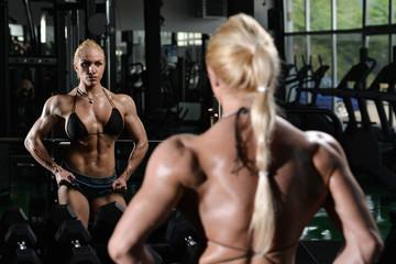 Muscular Woman Flexing Muscles