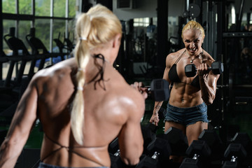 Woman Bodybuilder Exercise With Dumbbells