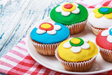 cupcakes decorated with colorful mastic poster