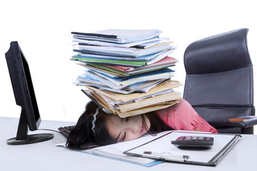 Female accountant with a pile of paperwork