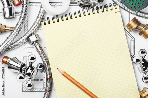 plumbing and tools with a notebook - 70106184