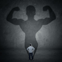 Businessman and strong shadow 3