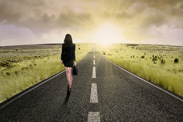 Businesswoman standing on the highway road 2