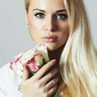 beautiful blond woman with flowers.girl and roses.close-up