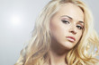 Fashion portrait of young beautiful woman.Blond girl. Curly