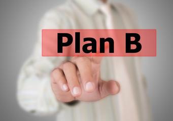 Businessman touching a button Plan B