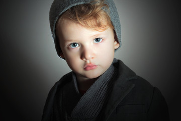 Winter Style Little Boy in cap.Handsome Child.Fashion Kids