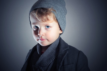 Winter Style Little Boy.Child in hat.Fashion Kids.Blue eyes