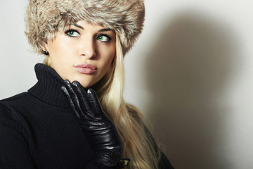 Beautiful Young Woman in Fur Hat.Blond Girl.Winter.gloves