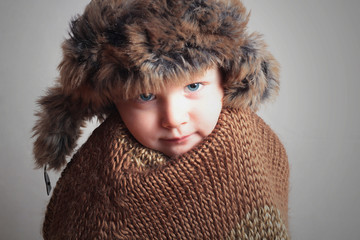 frozen child in fur Hat.fashion winter style.little boy.kidscold