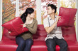 Couple quarreling and throwing pillow