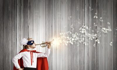Superkid with trumpet