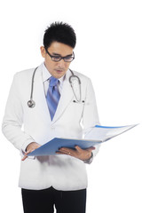 Doctor checking the medical record