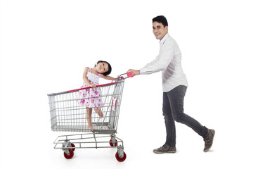 Father with his daughter on trolley