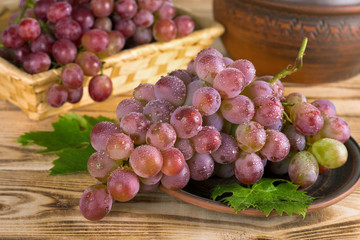 Tasty grapes on a background of a wooden table.