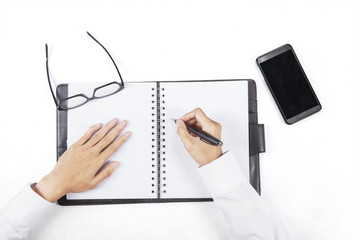Hands write a list on personal agenda