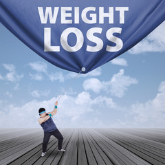 Man pulling weight loss banner 1