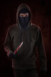 Murderer with bloody knife 1