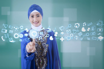 Muslim businesswoman using modern interface
