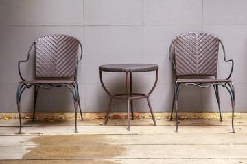 Two wicker chair near wall create a natural feel.