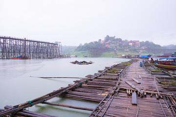 Broken wooden bridge and bamboo wood rafting