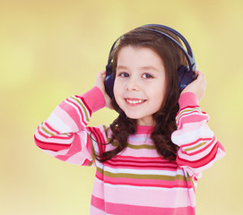 very musical little girl listening to music