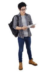 Trendy student holding digital tablet