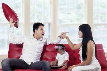 Two parents quarreling at home