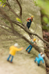 Miniature workmen clearing fallen trees top view