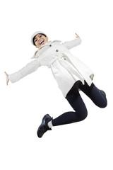 Woman in winter jacket jumping in studio