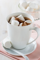 Cup of hot chocolate  with marshmallow on a white table